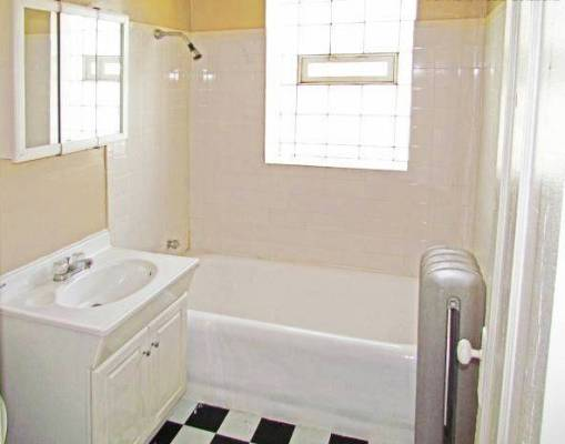 PHOTO - CHICAGO - 7400 CHAPPEL - BATH ROOM - EXAMPLE OF A FIXED-UP APARTMENT LOOKING MUCH AS IT DID - EDITED FROM REAL ESTATE IMAGE